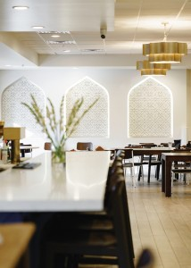 Maydoon's design aesthetic features modern interpretations of traditional Persian décor elements like recessed arches and gold light fixtures.