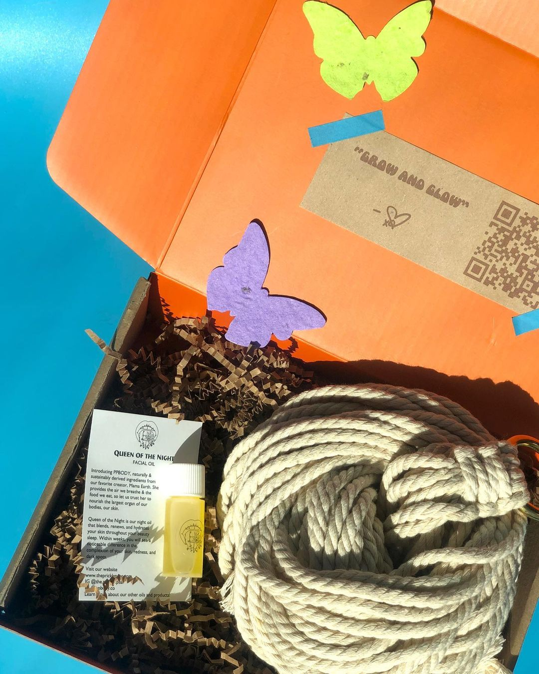 """Hella Happy Life's """"Grow and Glow"""" box with a face oil and tools to craft a macramé plant hanger"""