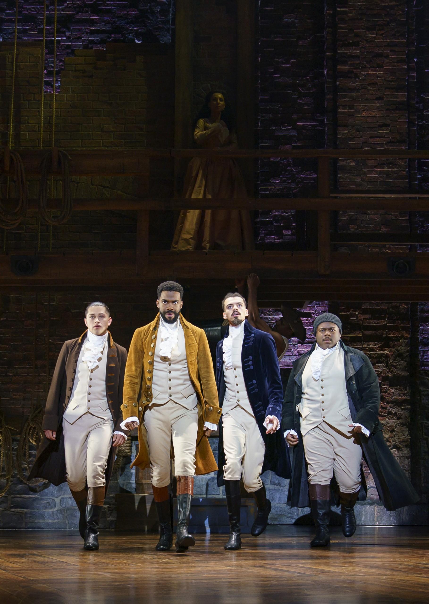 Four Hamilton actors in costume