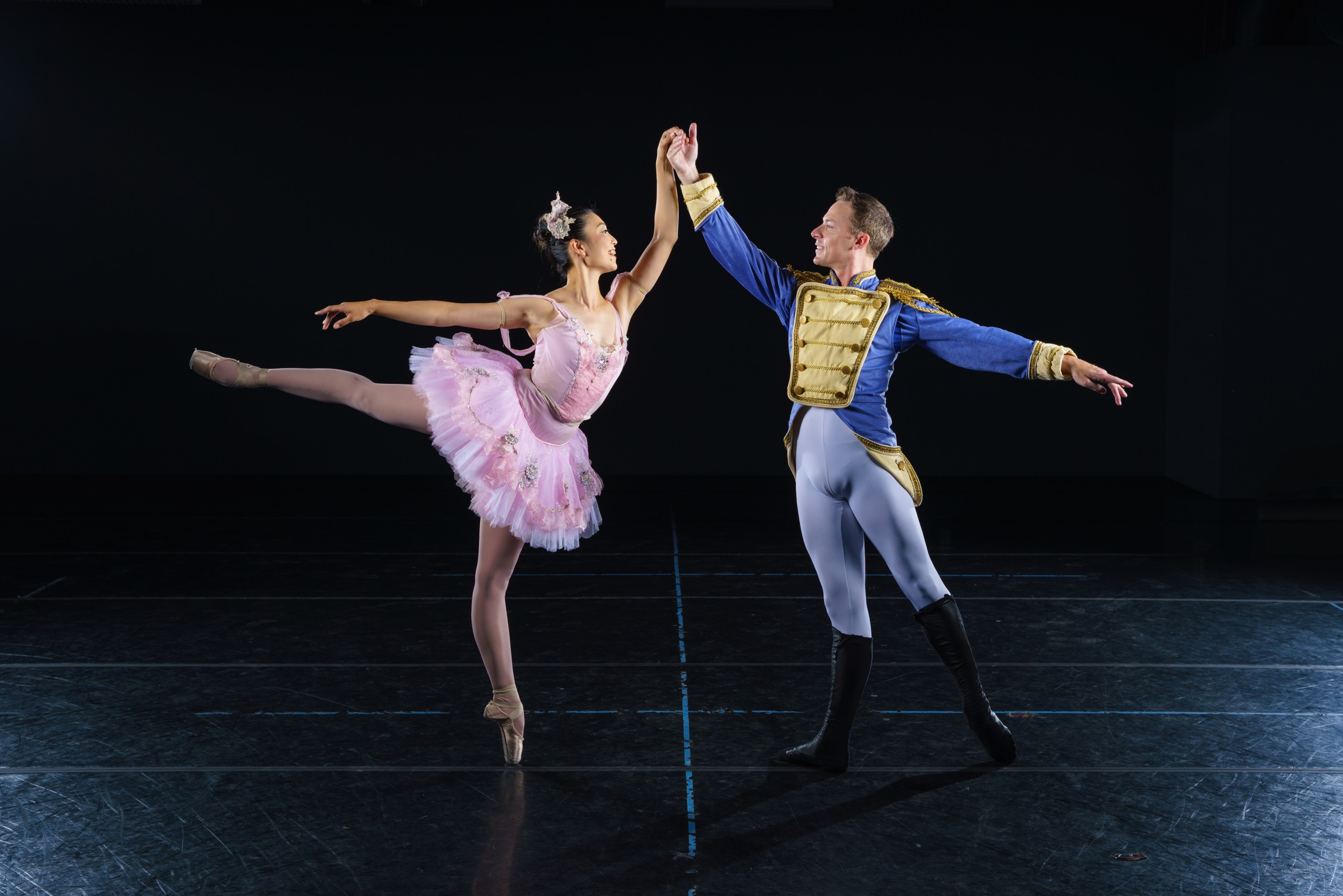 Photo of two ballet dancers in costume